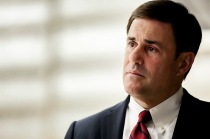 Arizona Governor Doug Ducey listens to presentations during his visit to the University of Arizona Steward Observatory Mirror Lab in Tucson, Ariz., Wednesday, March 11, 2015.