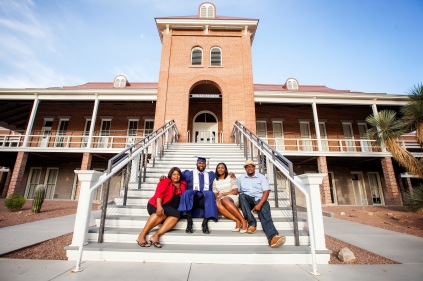 Earl Mitchell, 27, a defensive tackle for the Miami Dolphins, sits at the University of Arizona Old Main with his mom Lisa Hearron, sister Sekayla Watts and brother-in-law Eric Watts before his college convocation, getting a degree in general studies. Photograph by john de Dios
