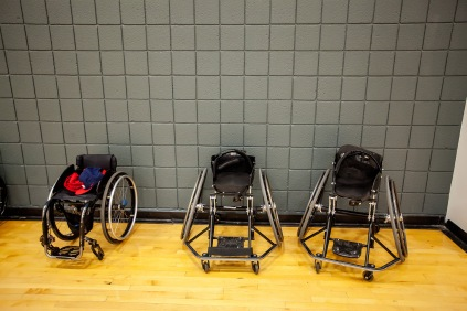 Wheelchairs, regular and of the sports variety, lined the sidelines during the veterans GPS sports camp at the UA Rec Center. Photograph by John de Dios/UANews
